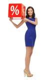 Mujer preciosa en vestido azul con la muestra del por ciento Fotos de archivo libres de regalías