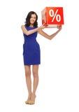 Mujer preciosa en vestido azul con la muestra del por ciento Fotografía de archivo libre de regalías