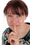 Mujer preciosa que sostiene el finger sobre boca Imagenes de archivo