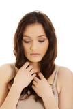 Mujer preocupante hermosa joven Imagen de archivo