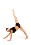 Mujer profesional joven del gimnasta Foto de archivo libre de regalías