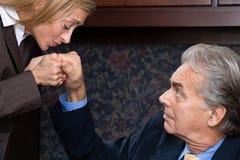 Mujer que besa la mano del hombre de negocios Imagenes de archivo