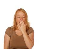 Mujer que bosteza Imagenes de archivo