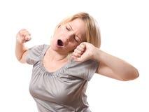 Mujer que bosteza fotografía de archivo