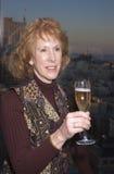Mujer que celebra con champán Fotos de archivo
