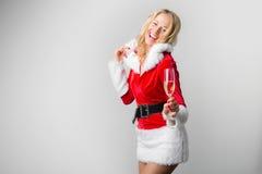 Mujer que celebra el Año Nuevo con champán Fotografía de archivo