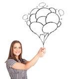 Mujer que celebra el dibujo de los globos Fotos de archivo