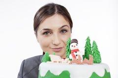 Mujer que celebra la Navidad Imágenes de archivo libres de regalías