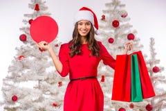 mujer que celebra la Navidad Imagen de archivo