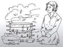 Mujer que cocina la comida Imagen de archivo