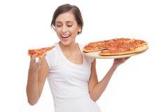 Mujer que come la pizza Fotografía de archivo libre de regalías