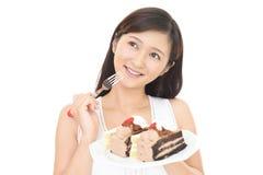 Mujer que come los dulces Imagenes de archivo