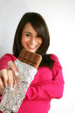 Mujer que come un chocolate Imagen de archivo
