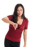 Mujer que da los pulgares abajo Foto de archivo libre de regalías