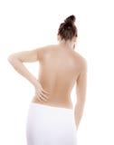 Mujer que da masajes a la parte posterior del dolor Foto de archivo libre de regalías