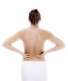 Mujer que da masajes a la parte posterior del dolor Imagen de archivo libre de regalías
