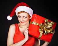 Mujer que desgasta el sombrero de santa Fotos de archivo libres de regalías