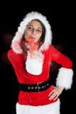 Mujer que desgasta el traje de Papá Noel Fotografía de archivo libre de regalías