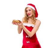 Mujer que desgasta la presentación de la ropa de Papá Noel Fotografía de archivo libre de regalías