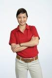 Mujer que desgasta una camisa roja Imagenes de archivo