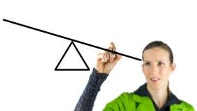 Mujer que dibuja una oscilación en una pantalla virtual Imagen de archivo libre de regalías