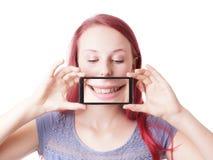Mujer que ensucia alrededor con el teléfono de la cámara Imágenes de archivo libres de regalías