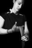 Mujer que envuelve sus manos Foto de archivo libre de regalías