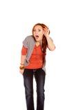 Mujer que escucha con choque e incredulidad Fotos de archivo