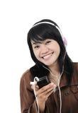 Mujer que escucha la música triste con el teléfono Imagenes de archivo
