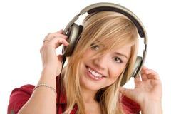 Mujer que escucha la sonrisa de la música Fotos de archivo