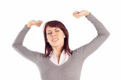 Mujer que estira sus brazos Imagenes de archivo