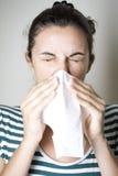 Mujer que estornuda Imagen de archivo libre de regalías