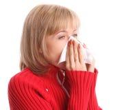 Mujer que estornuda Fotografía de archivo