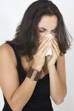 Mujer que estornuda Fotos de archivo