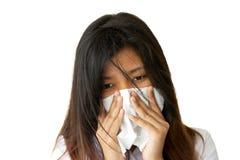 Mujer que estornuda Foto de archivo libre de regalías