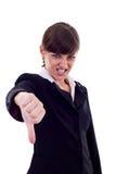 Mujer que gesticula los pulgares abajo Imagen de archivo libre de regalías