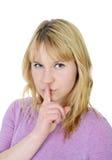 Mujer que gesticula silencio Imagen de archivo libre de regalías