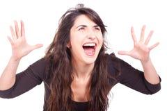 Mujer que grita con los brazos abiertos Fotografía de archivo libre de regalías