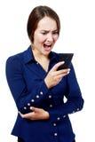 Mujer que grita en su teléfono Fotografía de archivo libre de regalías