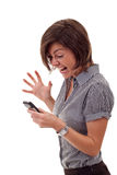 Mujer que grita a un móvil Fotos de archivo