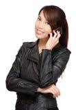 Mujer que habla en el teléfono Imagen de archivo libre de regalías