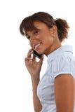 Mujer que habla en herphone imagen de archivo libre de regalías
