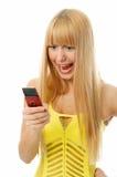 Mujer que habla en teléfonos celulares Imagen de archivo libre de regalías