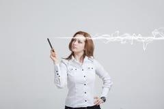 Mujer que hace el efecto mágico - relámpago de destello El concepto de copywriting o de escritura Imagen de archivo
