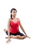 mujer que hace estirar de su detrás ejercicio imagen de archivo libre de regalías