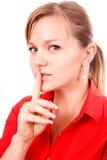 Mujer que hace gesto del silencio Foto de archivo libre de regalías