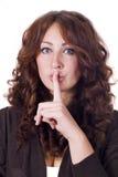 Mujer que hace gesto del silencio Imagenes de archivo