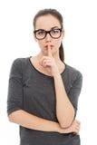 Mujer que hace gesto del silencio Fotografía de archivo