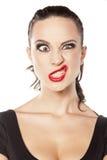 Mujer que hace la cara divertida Fotografía de archivo