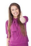 Mujer que hace la muestra aceptable con una sonrisa Imagenes de archivo